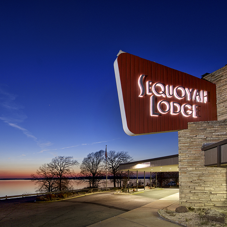 Classic Lodge signage overlooking lake